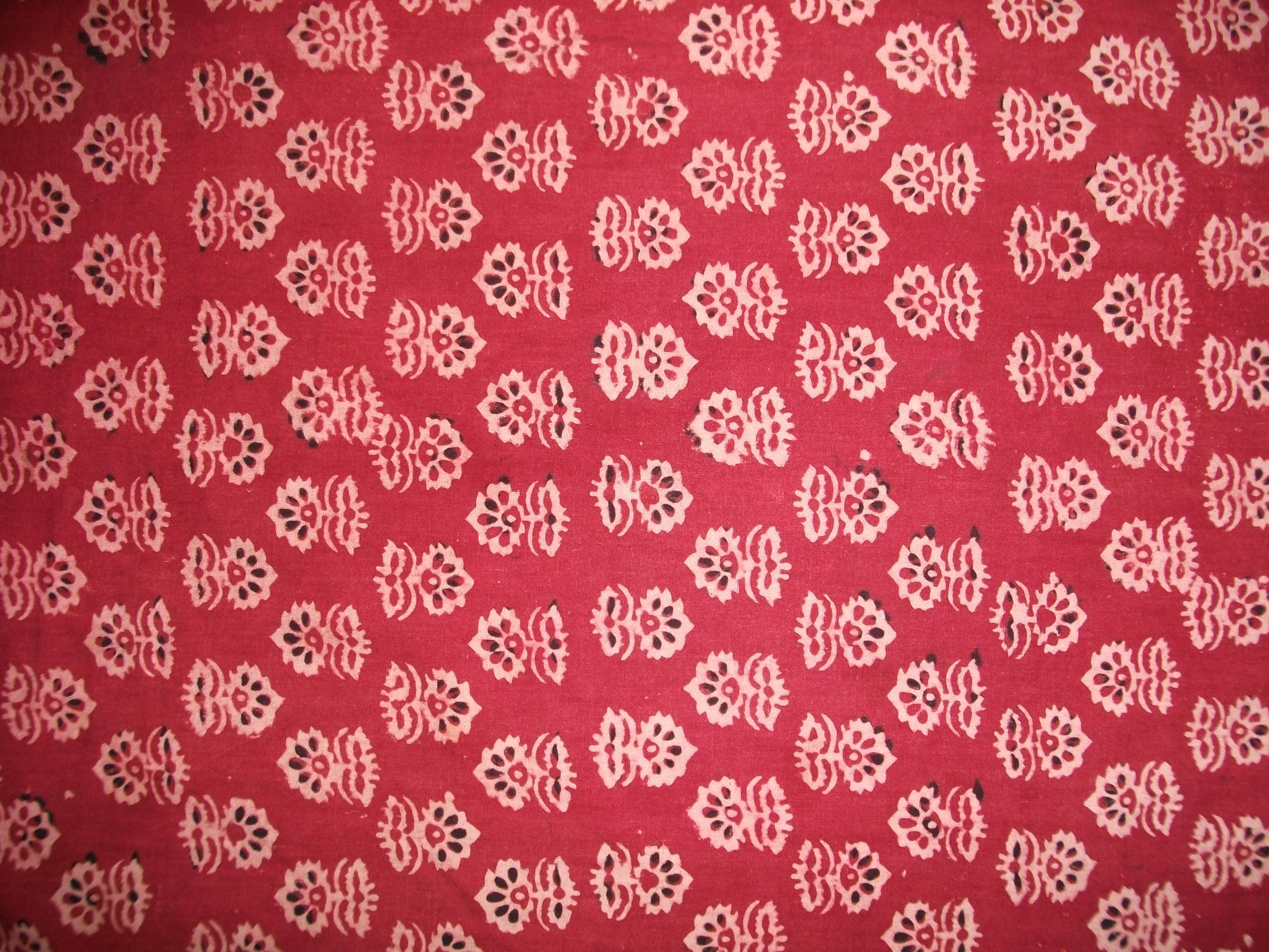 """Vegetable Dye Block Print with Beautiful Traditional Pattern on Brick Red Background"""