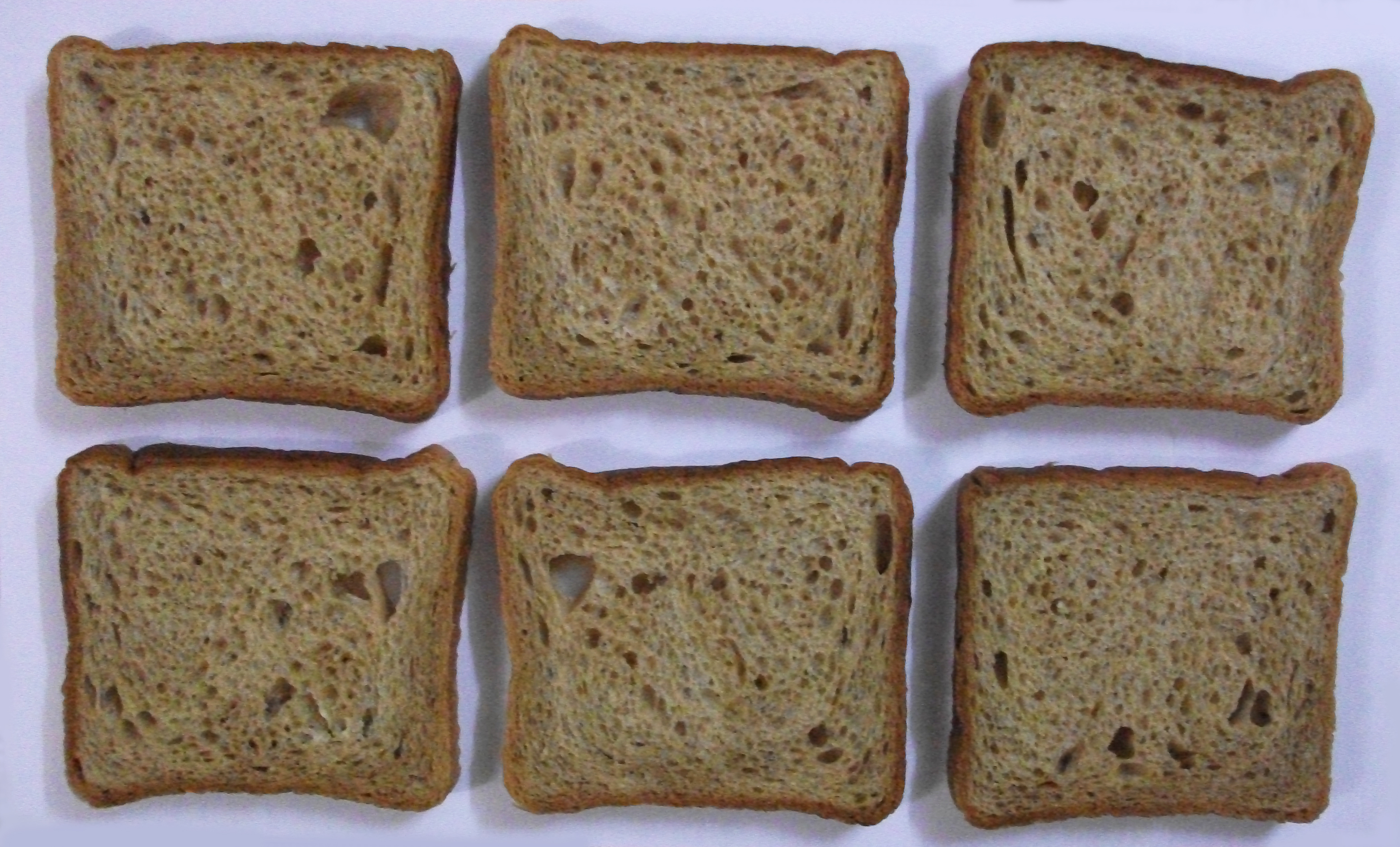 """Brown Bread Slices On White Background"""